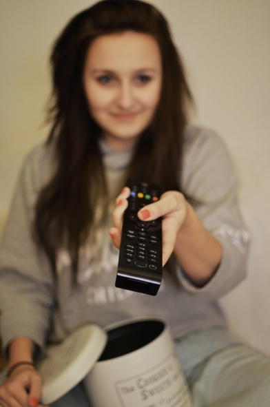 woman-girl-remote-watching